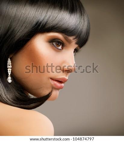 Haircut. Hairstyle. Beautiful Brunette Girl. - stock photo