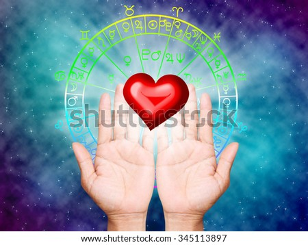 hand and love the horoscope concept. - stock photo