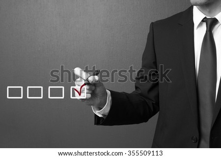 Hand choosing one of many options - stock photo