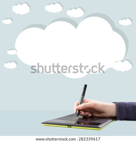 hand drawing a graph on the tablet with  - stock photo