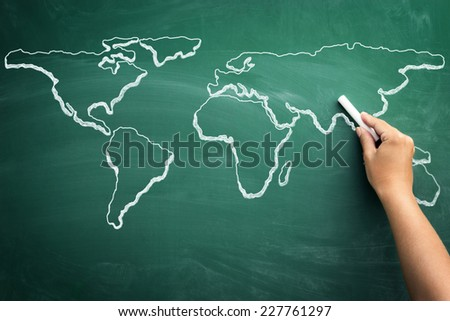 Hand drawing world map on a school blackboard  - stock photo