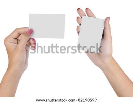 Hand holding an empty business card isolated on white background - stock photo