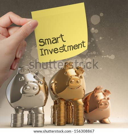 hand holding smart investment with sticky note on winner piggy bank as concept - stock photo