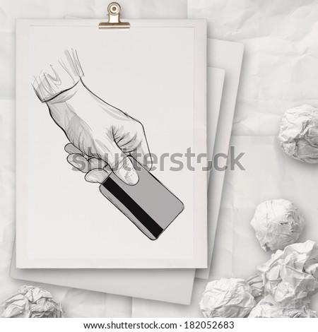 hand holding up credit card on book  as concept  - stock photo