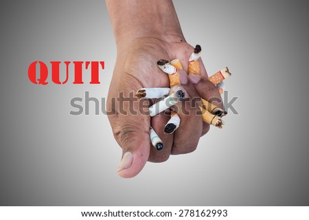 Hand Man Crushing Cigarettes Concept No Smoking on gray background - stock photo