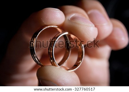 hand of groom with wedding rings, closeup - stock photo