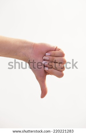 Hand Showing Thumb Down Sign - stock photo