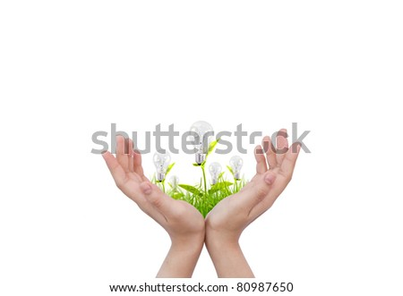 Hand with Light bulb - stock photo