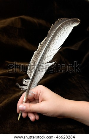 Hand writting with feather - stock photo