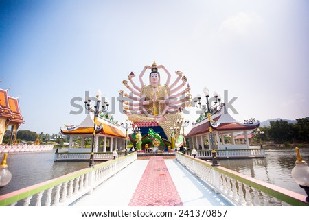 18 hands God statue on blue sky in Koh Samui, Thailand - stock photo