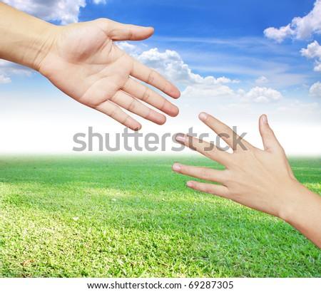 Hands Help - stock photo