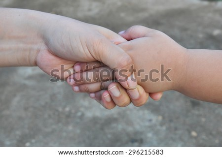 hands of mother and child closeup - stock photo