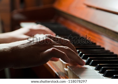 Hands playing the piano (close-up) - stock photo