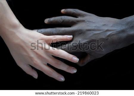 Handshake, concept of no apartheid. Hands black and white - stock photo