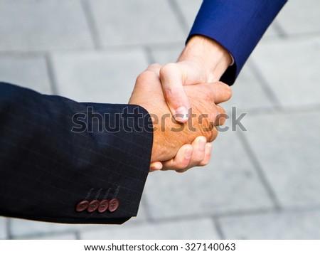 handshake outdoors - stock photo