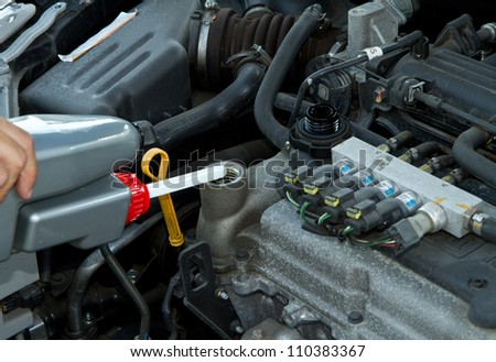 Handsome mechanic working in auto repair shop - stock photo