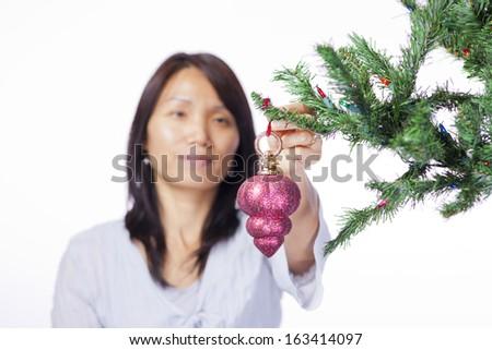 Hanging ornament on tree. - stock photo
