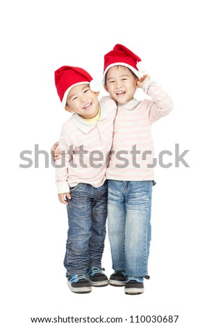 happy asian kids with Christmas hats - stock photo