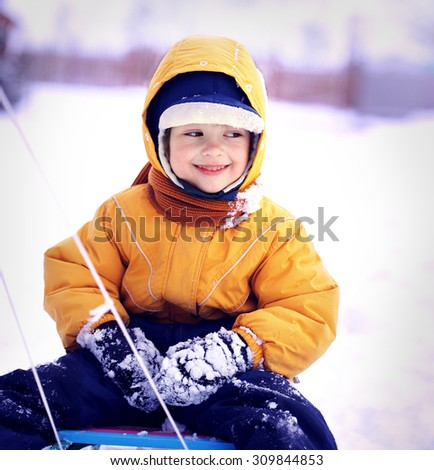 happy boy with sled - stock photo