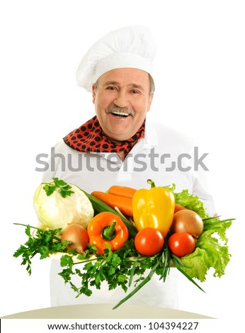 Happy chef holding vegetables - stock photo