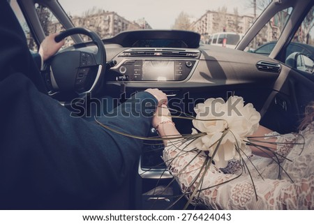happy couple driving in the car  - stock photo