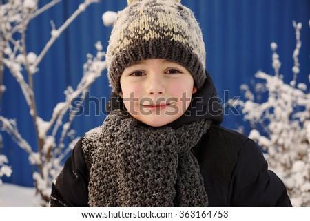Happy cute boy walking outside,close up portrait - stock photo