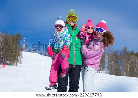 happy family in winter clothing at the ski resort - stock photo