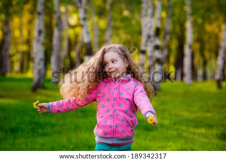 Happy girl running in the park. Wind blows hair. Happiness, summer - stock photo
