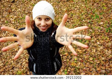 Happy girl with hands up outdoors. - stock photo
