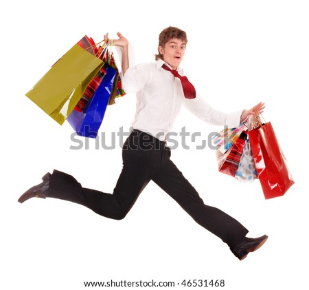 Happy man with shopping bag run. Isolated. - stock photo