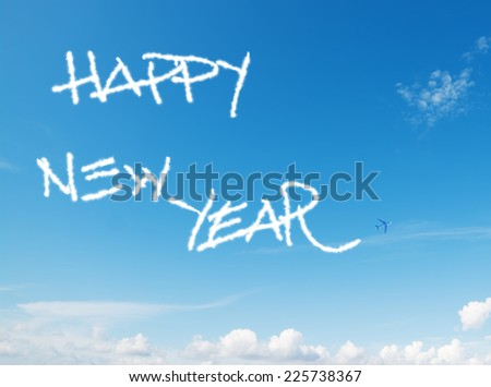 """happy new year"" written in the sky with contrails left by airplane - stock photo"