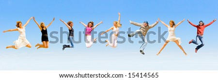8 happy people jumping with joy - stock photo