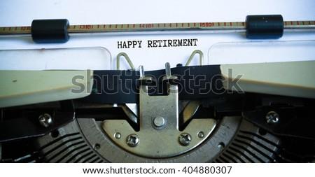 Happy retirement concept on typewriter  - stock photo