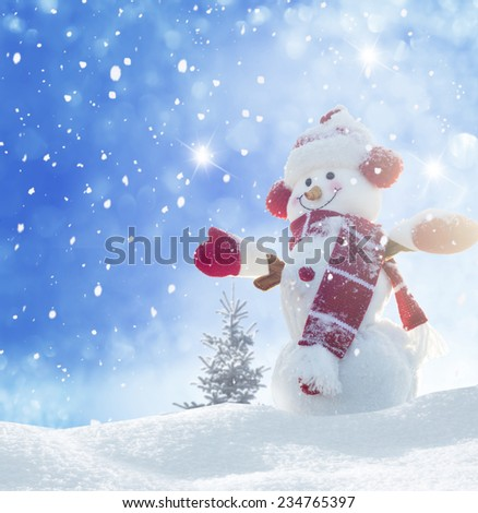 Happy snowman standing in winter christmas landscape  - stock photo