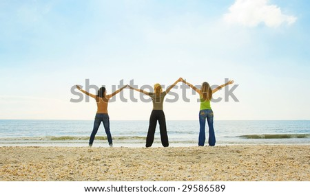 happy teenagers on the beach - stock photo