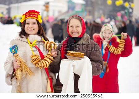 happy women celebrating  Maslenitsa festival at Russia - stock photo