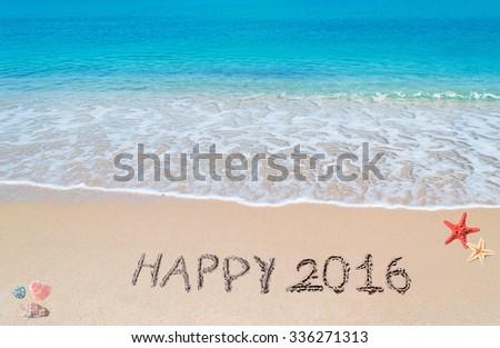 """happy 2016"" written on a tropical beach - stock photo"