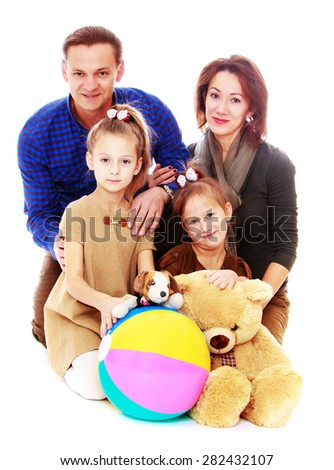 happy young family dad mom and two daughters- isolated on white background - stock photo