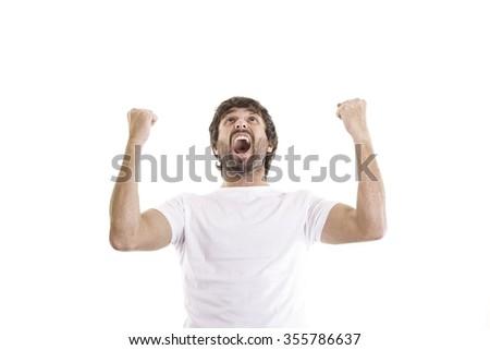 happy young man celebrating - stock photo