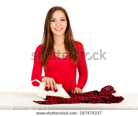 happy young pretty woman ironing clothes, white background - stock photo