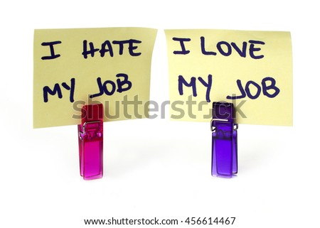 """Hate and Love"" messages written on a yellow paper note with a clothespins holding isolated over a white background - stock photo"