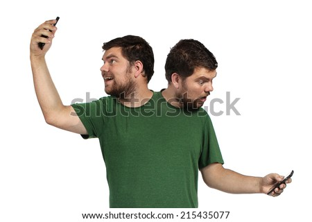 2 headed person taking a selfie and checking his phone on a white background - stock photo