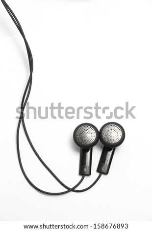 headphones are small and without headband, but are inserted in the ear canal itself.  - stock photo