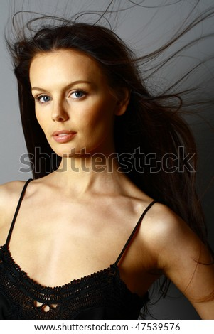 healthy beautiful long hair in motion created by wind, fashion look - stock photo