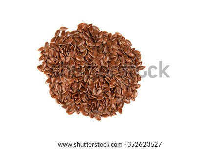 Heap of brown flax seed or linseed on white background. Diet healthcare healthy food.  - stock photo
