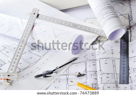 heap of design and project drawings on  table - stock photo