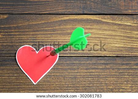 Heart pierced by an arrow - stock photo