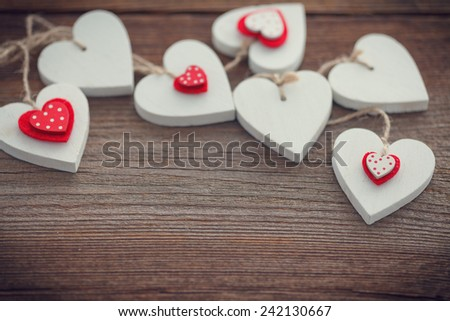 hearts on wooden board for valentines day - stock photo