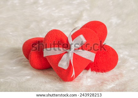 3 hearts overlapping, on the fur. - stock photo
