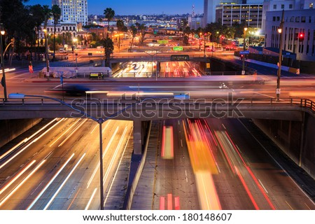 Heavy traffic in Los Angeles city at rush hour. Long exposure. - stock photo